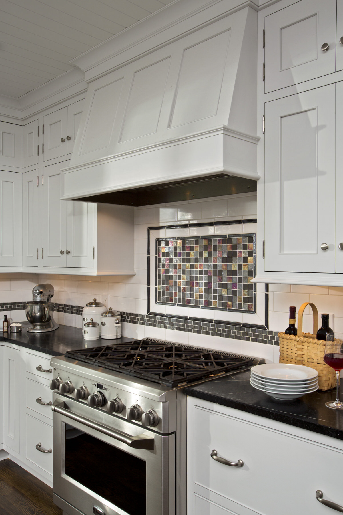 Once the literal hearth and center of the kitchen the range backsplash is always a ready place to make a statement.