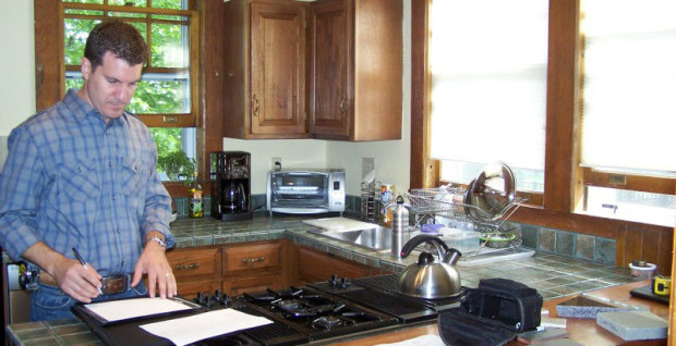 Teakwood Builders Owner Jim Sasko planning kitchen work.