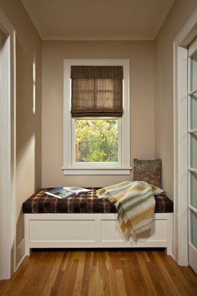 A cozy window seat with storage concealed by the hinged bench top is tucked neatly between a mudroom entry and new powder bath in this historic Albany home renovated by Teakwood Builders of Saratoga Springs, NY.