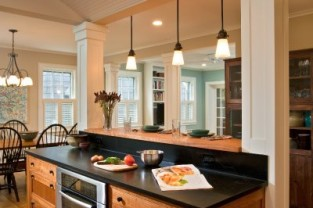Soapstone countertops, tailored cherry cabinetry and Craftsman columns and millwork give this new kitchen in Saratoga Springs, NY, historical credibility.