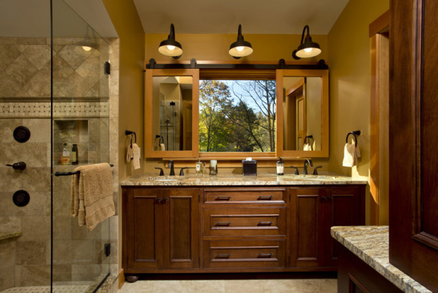 Sliding mirrors provide privacy or view as desired in this modern cabin bathroom design by Saratoga Springs, NY, custom builder Teakwood Builders.