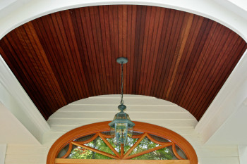 Detail of beadboard millwork entryway arch. Please contact Teakwood Builders in Saratoga Springs, NY, to see how we can help you get started on your home renovation or new construction project.