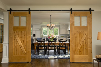 Modern farmhouse dining room by Saratoga Springs building and remodeling specialist Teakwood Builders