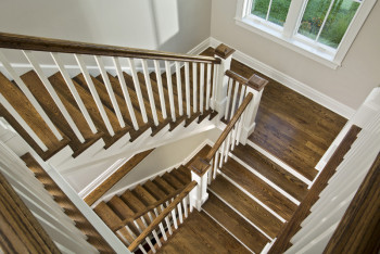 Custom staircase. Teakwood Builders is the Saratoga region's specialist in luxury, vacation and 2nd-home construction, historic restorations and kitchen and bath remodeling.