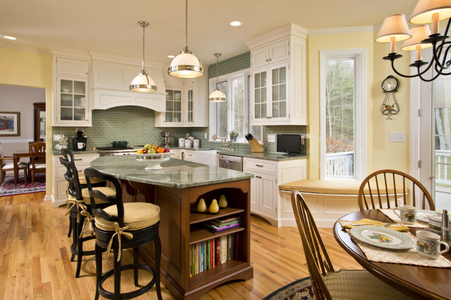 This kitchen island provides additional storage for cookbooks, as well as casual bar seating.