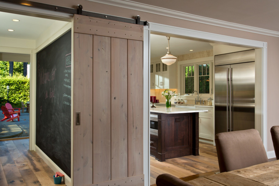 Hanging barn door sliders add flexibility and rustic panache to the summer home.