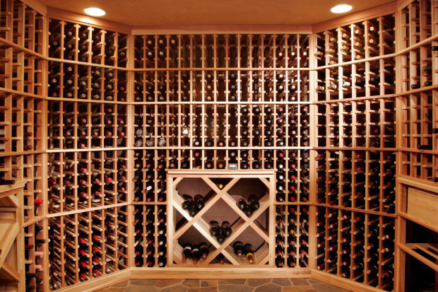 ThisTeakwood Builders remodeling project turned a basement into a Tuscan-style wine cellar with whimsical visuals and this efficient and elegant wine storage room.