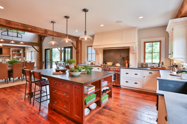With a mantel-style hood, which rests on the counter, it's important to have enough space to the left and right of the range to slide a pan off the burner onto the counter. By Teakwood Builders, kitchen and bath remodeler, custom home builder and general contractor Saratoga Springs and Capital Region.