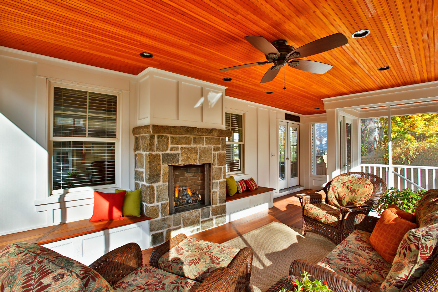screened in porch with fireplace. A Stone Surround And Board Batten Upper Mantle Makes The Fireplace An Attractive Center Of Attention For This Screened Porch. In Porch With
