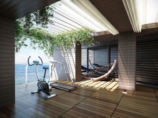 Home gym with a view, found on architectureartdesigns.com. No designer credited.