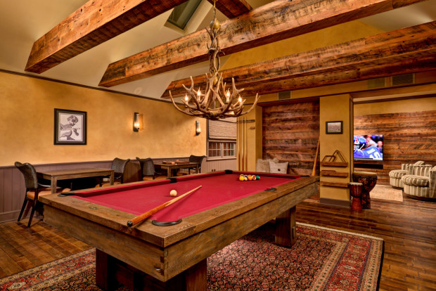 Home Game Rooms: Saratoga Springs general contractor Teakwood Builders used a built-in cubby to give adults and kids a space to enjoy.