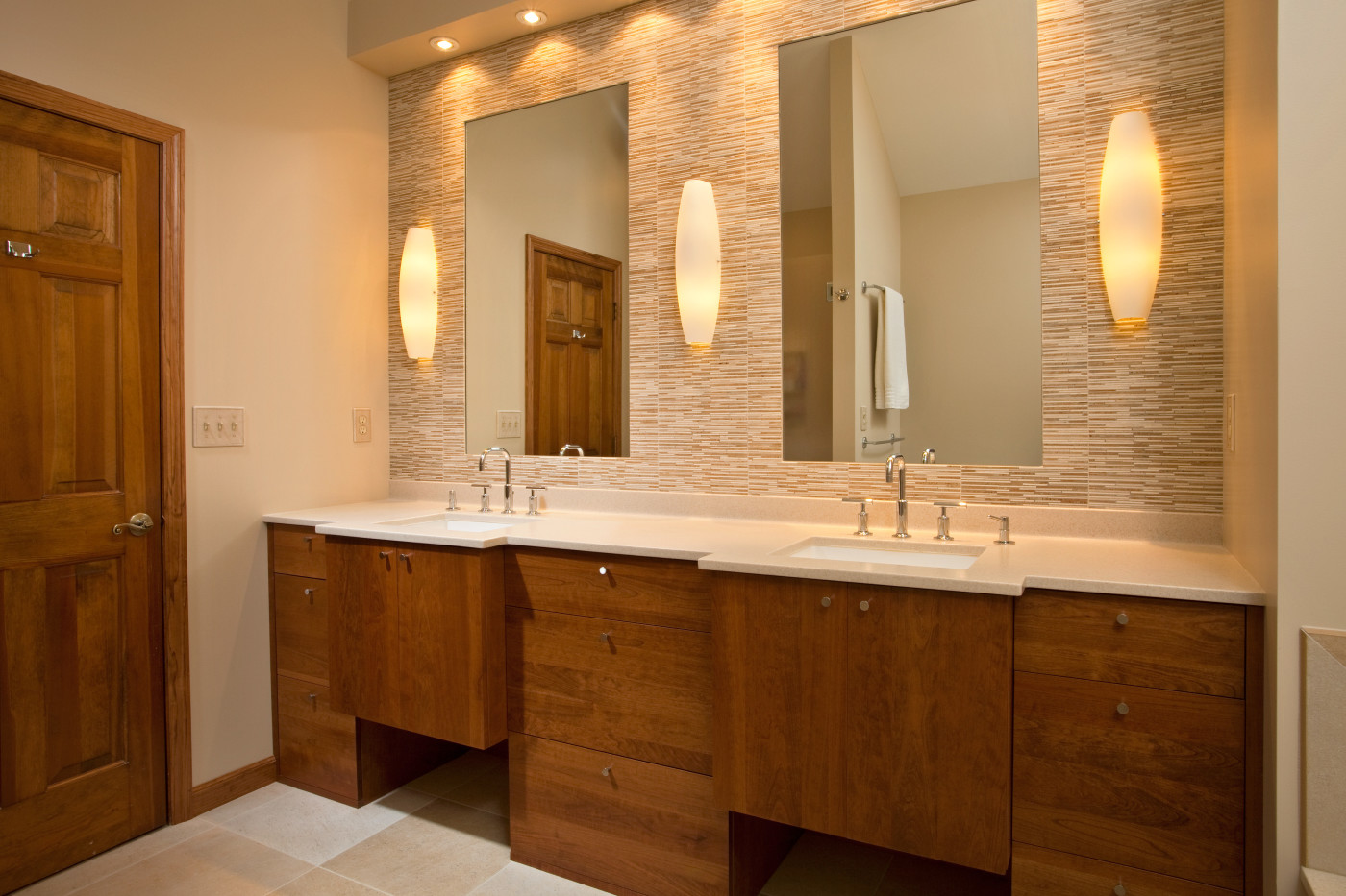 teakwood builders applied long clean lines while designing the remodel for both the kitchen and bath