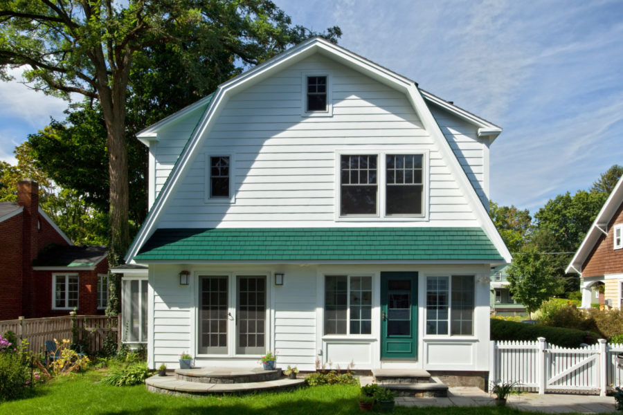The new addition matches seamlessly with the traditional style of this Dutch Colonial.