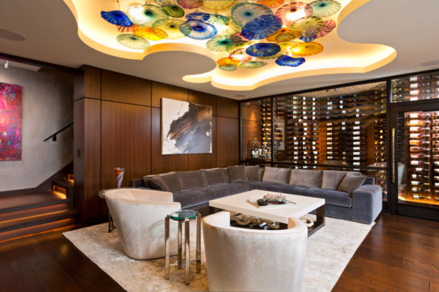 As business owners themselves, the homeowners were very conscious throughout the basement renovation project to support as many local artisans and craftsman as possible. Examples of this are seen most clearly in their love of abstract art displayed around the basement.