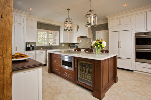 Custom panels help the French-door Sub-Zero 42-inch refrigerator and dishwasher blend with the cabinetry. To create an entertaining area separate from the cooking zone, the clients opted for a bar across from the breakfast table.